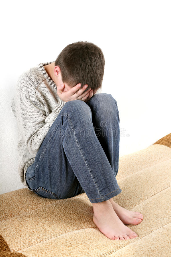 Download Sad teenager stock photo. Image of look, face, down, couch - 24769276