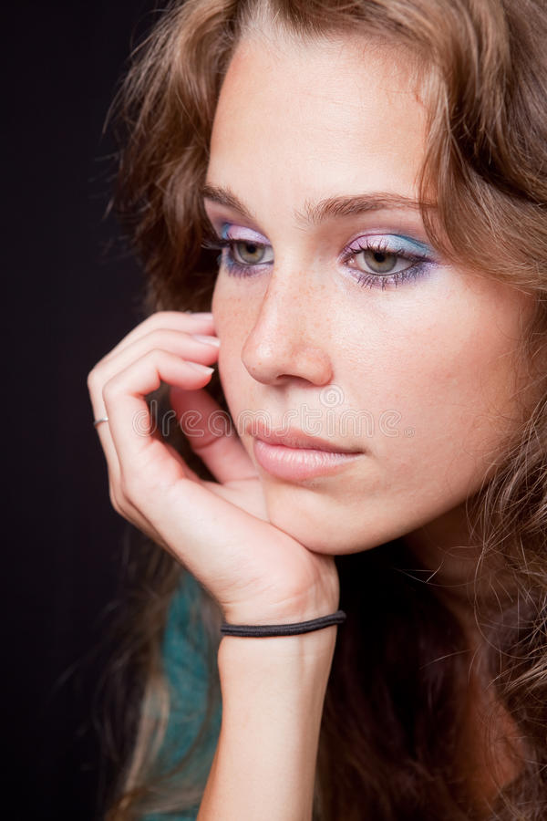 Sad thoughtful pensive woman. Over dark background stock image