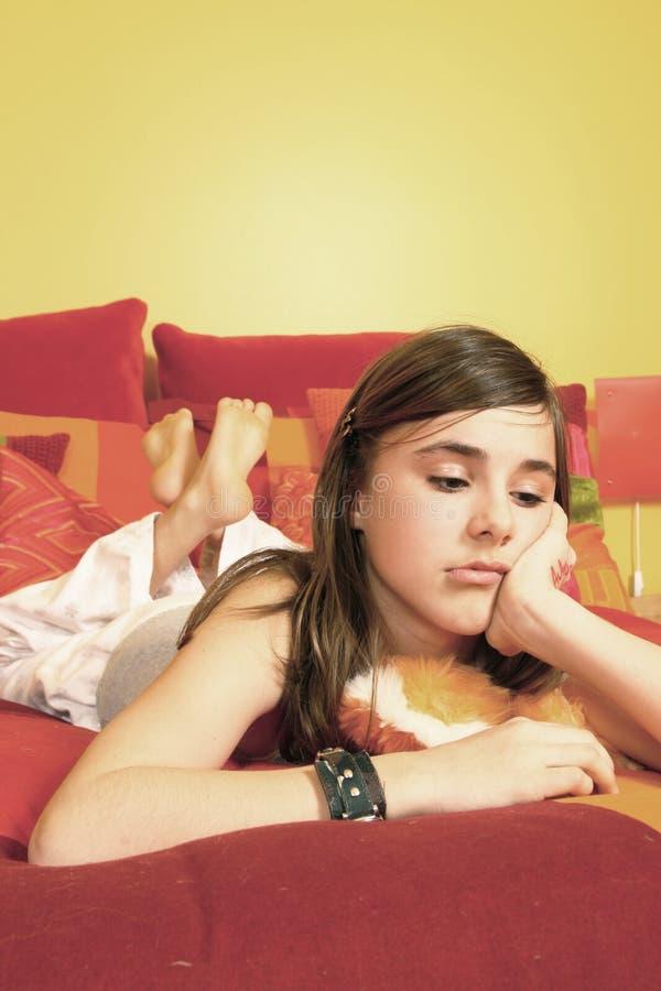 SAD tonårs- för underlagflicka royaltyfri foto