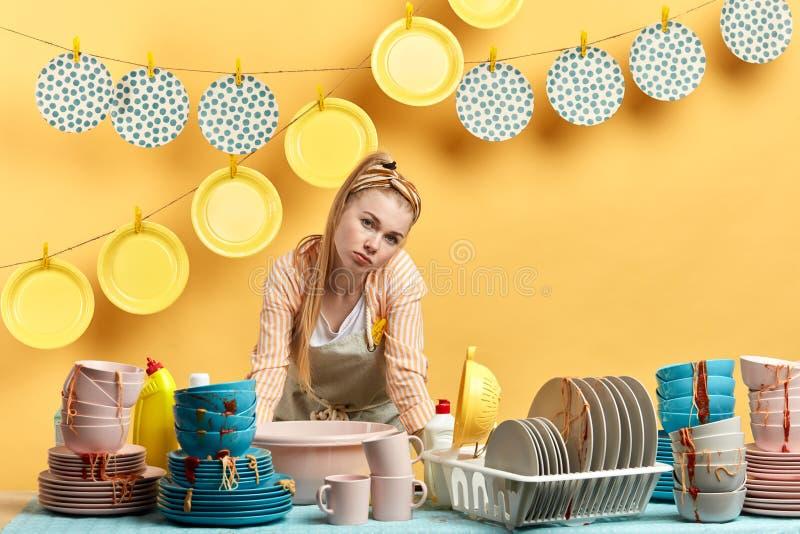 Sad unhappy housewife is hates housework royalty free stock photos