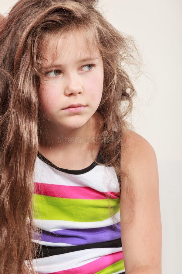 Sad unhappy little girl kid portrait. Portrait of sad unhappy little girl kid. Lonely depressed child. Bad mood stock images