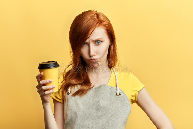 Sad unhappy saleswoman with a cup of coffee stock photography
