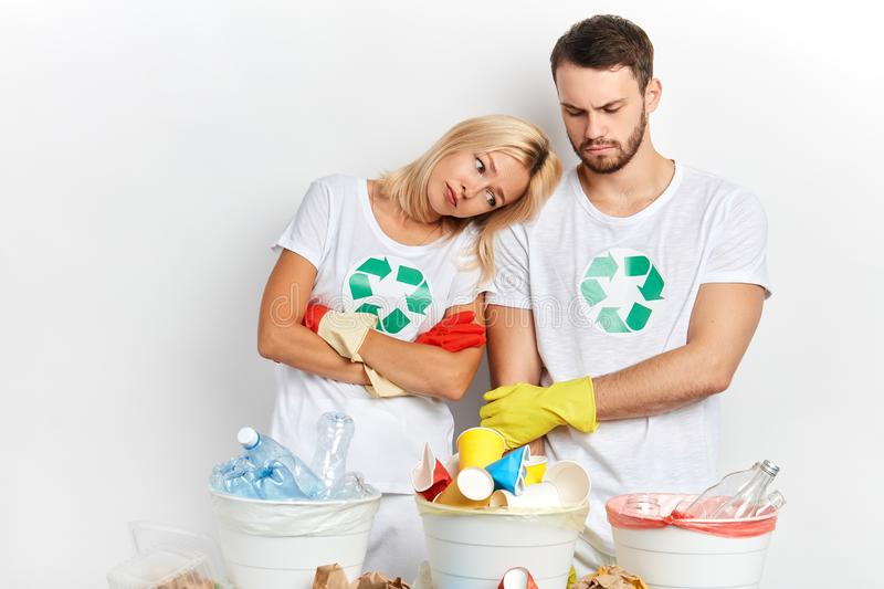 Sad unhappy woman and man isn`t satisfied with ecologial program stock photo