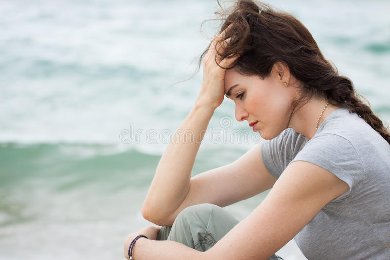 Sad and upset woman deep in thought stock photo