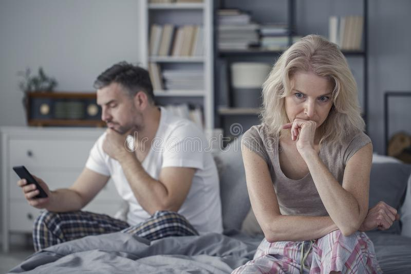 Sad wife and cheating husband royalty free stock photo