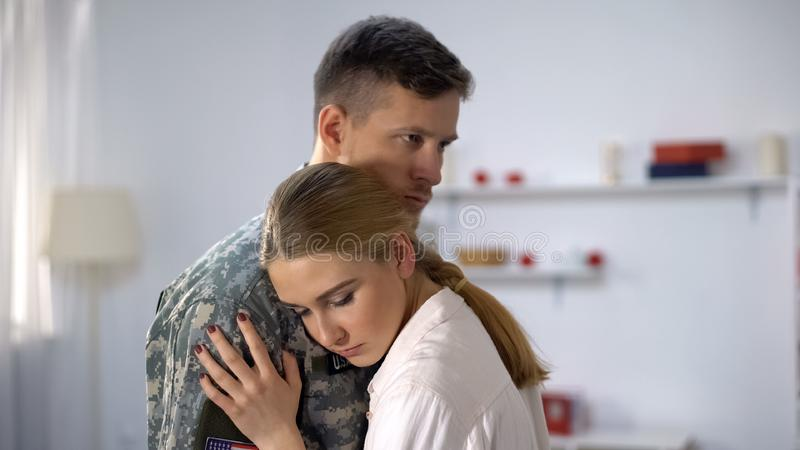 Sad wife hugging military officer, goodbying before duty, support and care, love. Stock photo stock photography