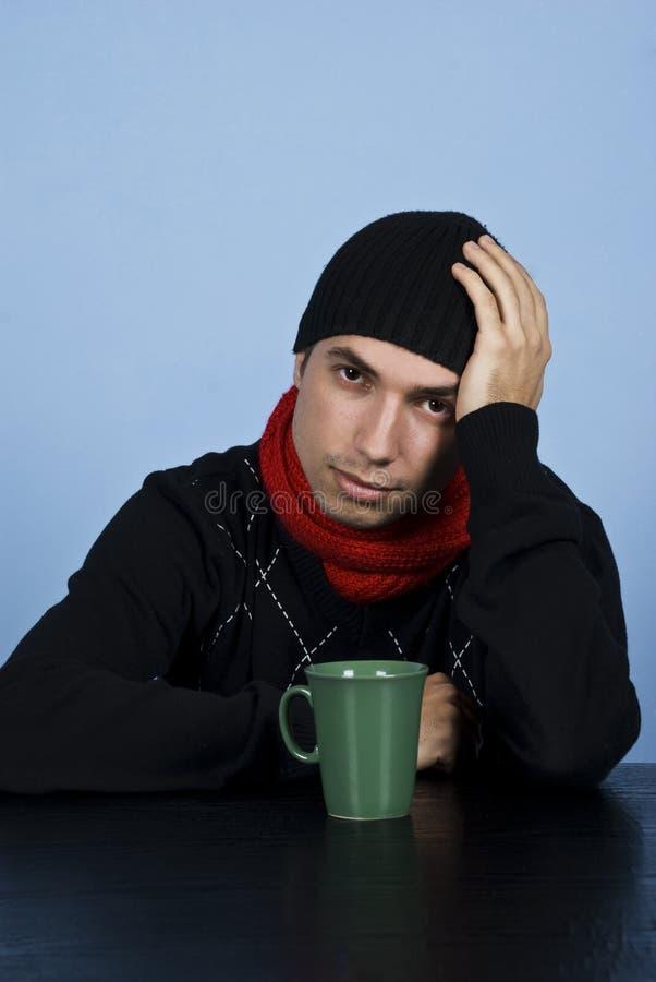 Free Sad Winter Man At Table Royalty Free Stock Images - 12008189