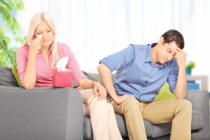 Sad woman arguing with her husband at home royalty free stock photography