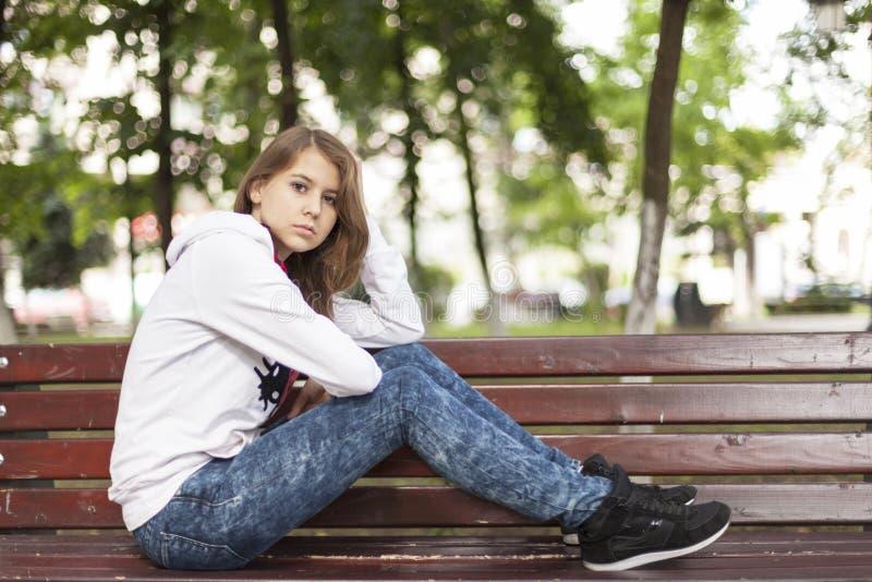 Sad woman on a bench royalty free stock photo