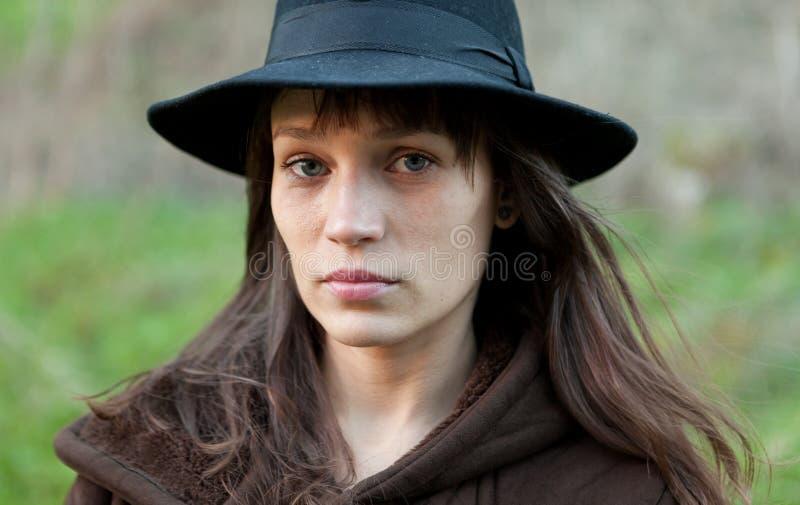 Sad woman with black hat royalty free stock photos