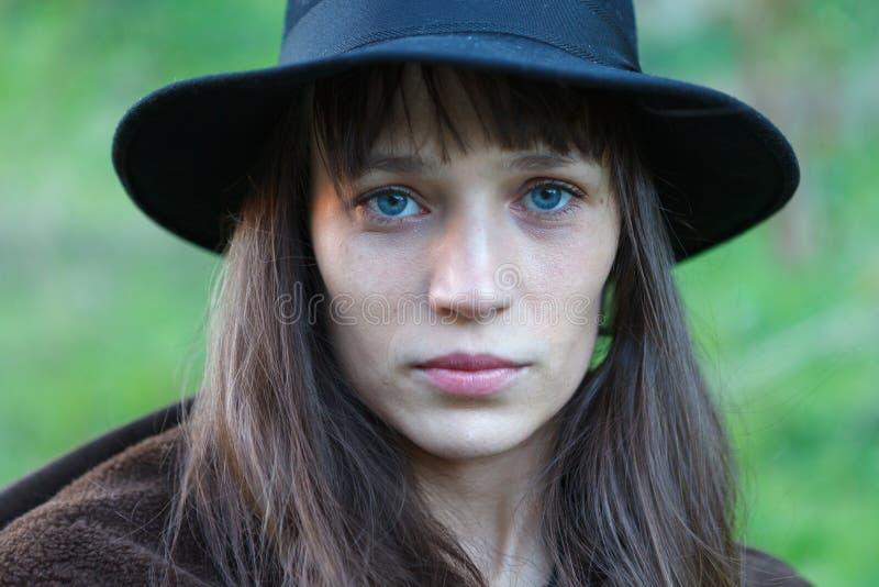 Sad woman with black hat stock photo