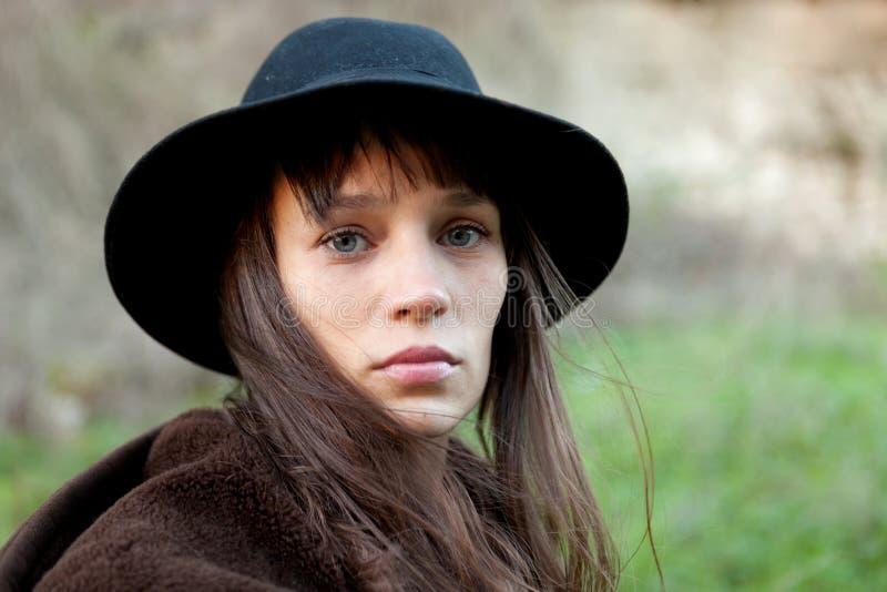 Sad woman with black hat stock image