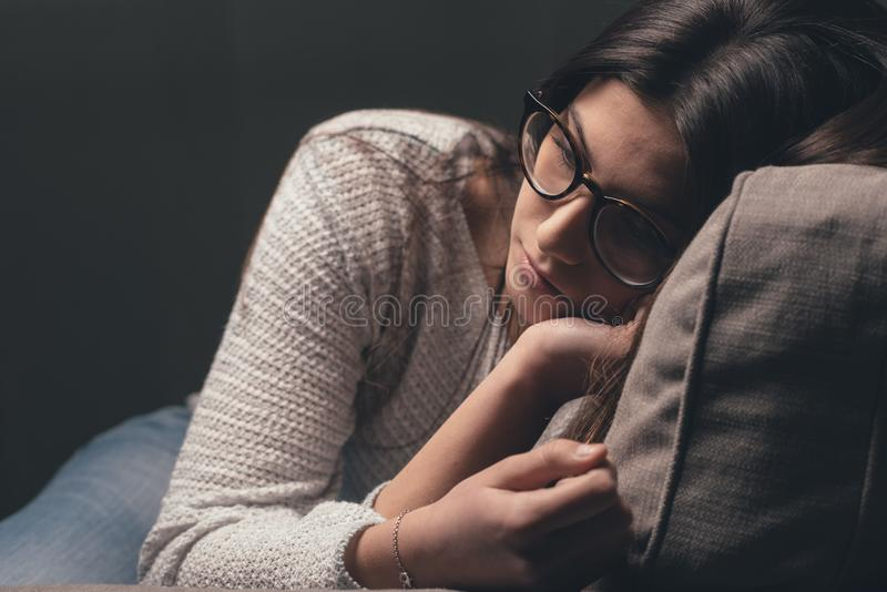 Download Sad Woman On The Couch At Home Stock Photo - Image of lonely, exhaustion: 92751804