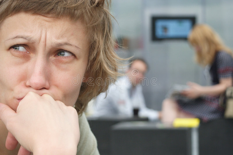 Sad woman with couple in background stock photography