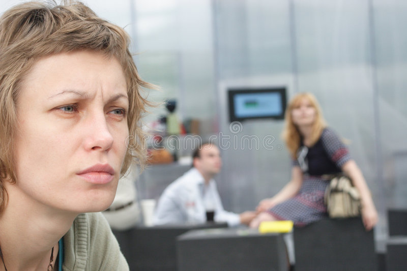 Sad woman with couple in background royalty free stock photo