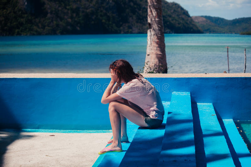 Sad woman in empty swimming pool stock images