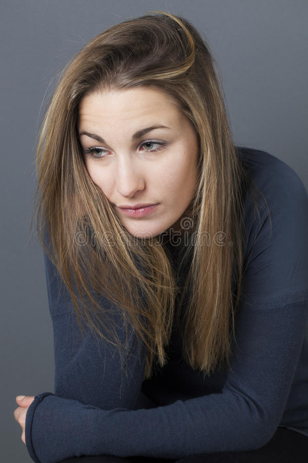 Sad woman expressing loneliness and emptiness stock image