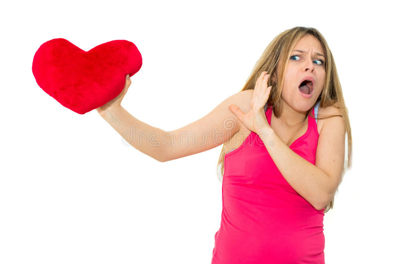 Sad woman holding red valentine heart. Young lonely sad woman holding red valentine heart stock image