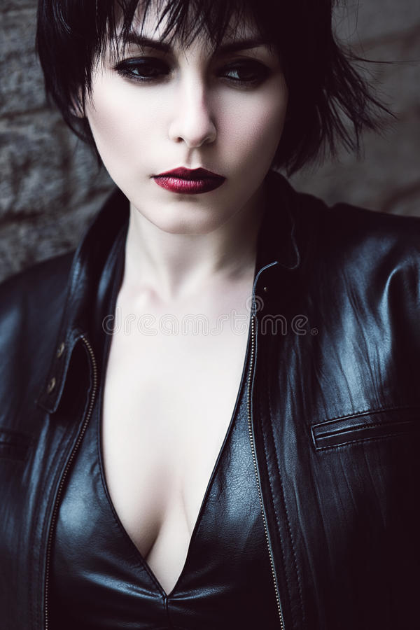 Sad woman in leather jacket royalty free stock image