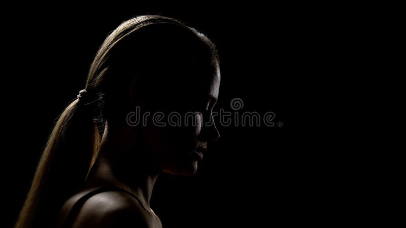 Sad woman looking down having life difficulties, feeling frustrated and insecure. Stock photo royalty free stock photos