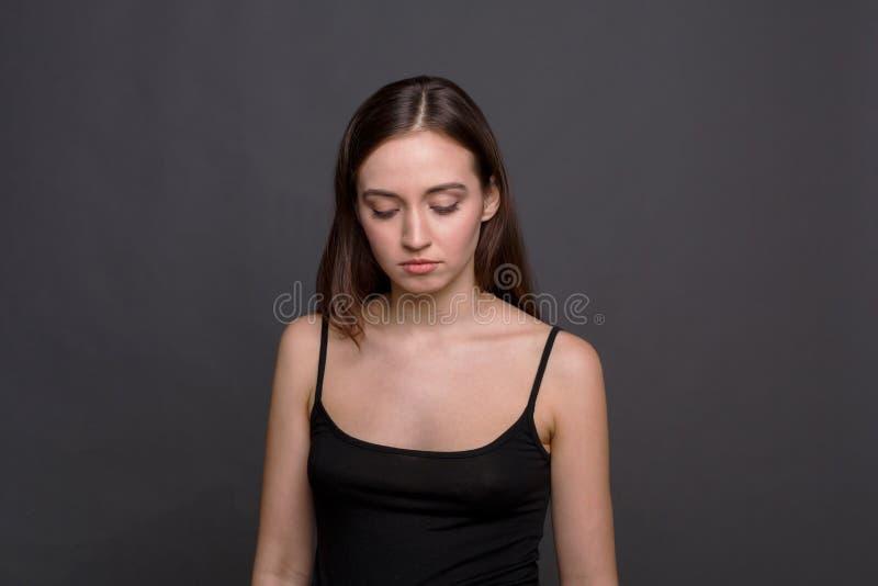 Sad woman looking down portrait stock image