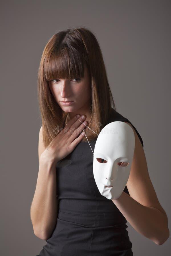 Sad woman with mask stock photo