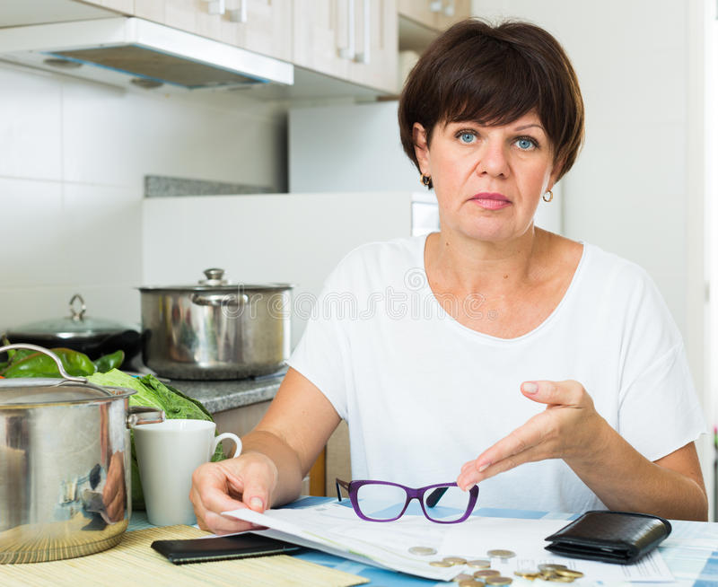 Download Sad Woman Paying Bills Stock Photo - Image: 83702216