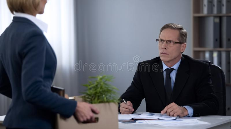 Sad woman quitting company job, poor work conditions, discrimination. Stock photo royalty free stock photo