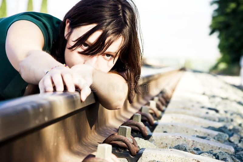 Sad woman on railtrack royalty free stock images