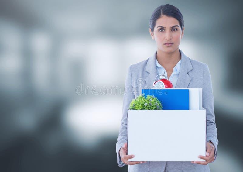 Sad woman redundant with box of office job equipment. Digital composite of Sad woman redundant with box of office job equipment stock photos