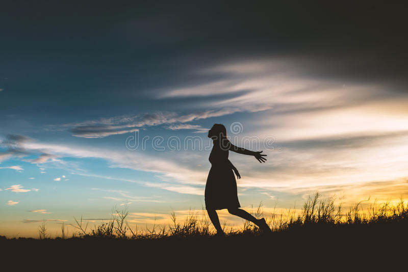 Sad woman runing at meadows try to forget bad thing. royalty free stock images