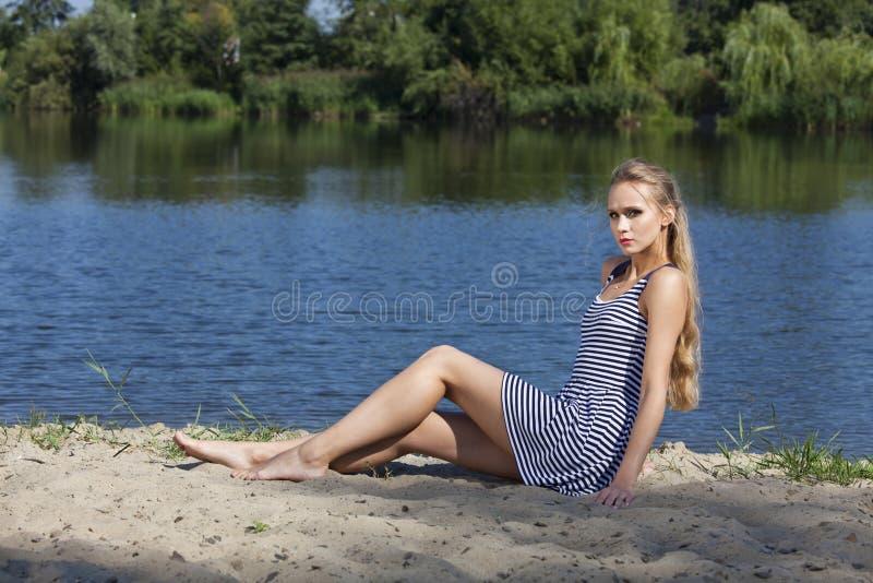 Sad woman on the beach stock photos
