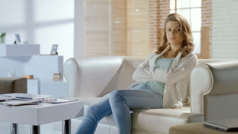 Sad woman sitting on couch thinking about life difficulties, middle age crisis. Stock photo royalty free stock photos