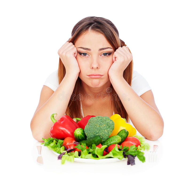 Sad woman with vegetables royalty free stock images