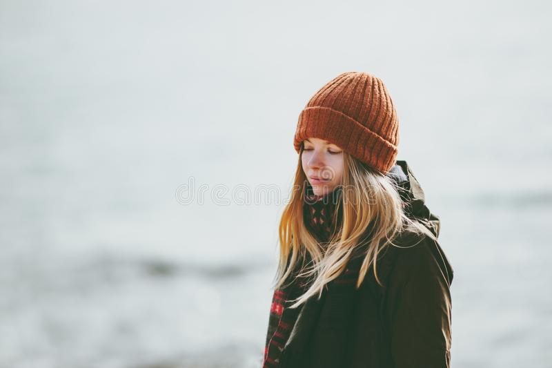 Sad Woman at winter beach cold sea outdoor depression emotions Lifestyle royalty free stock image