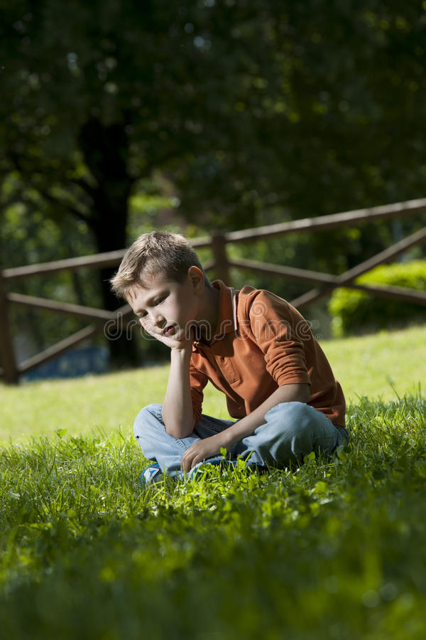 Download Sad/worried little boy stock image. Image of person, selective - 25927393
