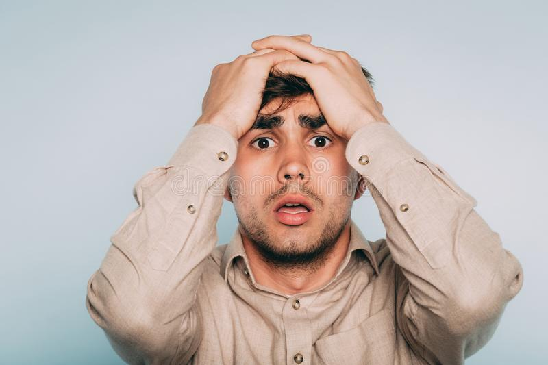 Sad worried scared afraid man pull hair out emotion royalty free stock images