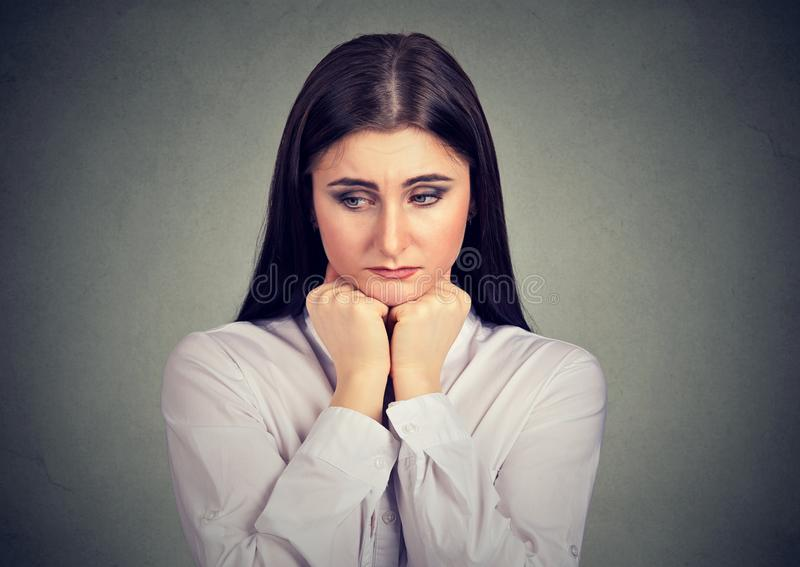 Sad youn girl looking melancholic royalty free stock photos