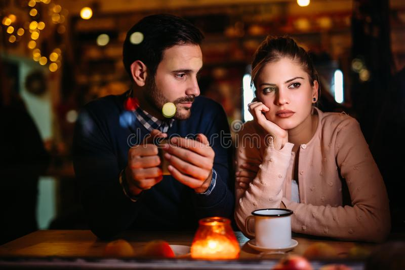 Sad couple having conflict and relationship problems stock images