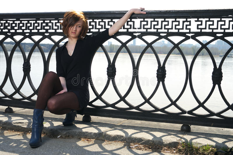 Sad Young Female Sitting Near Royalty Free Stock Photography