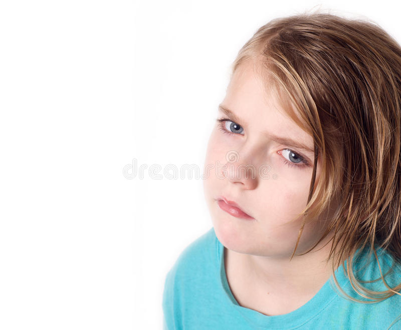 Sad young girl. Portrait of sad young girl with blond hair isolated on white background royalty free stock images