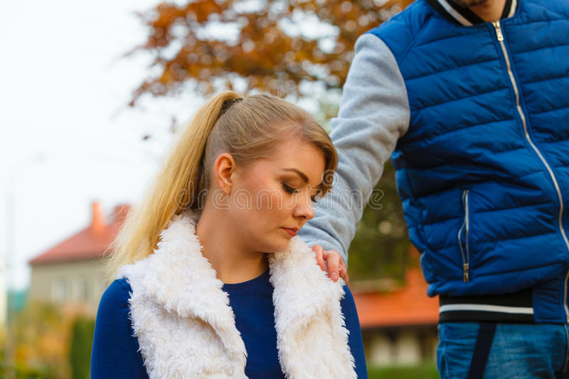 Sad young girl sit outdoors with friend. Mental problems stress and fatigue. Seasonal depression and sadness. Seeking help and assistance. Tired young women sit royalty free stock images