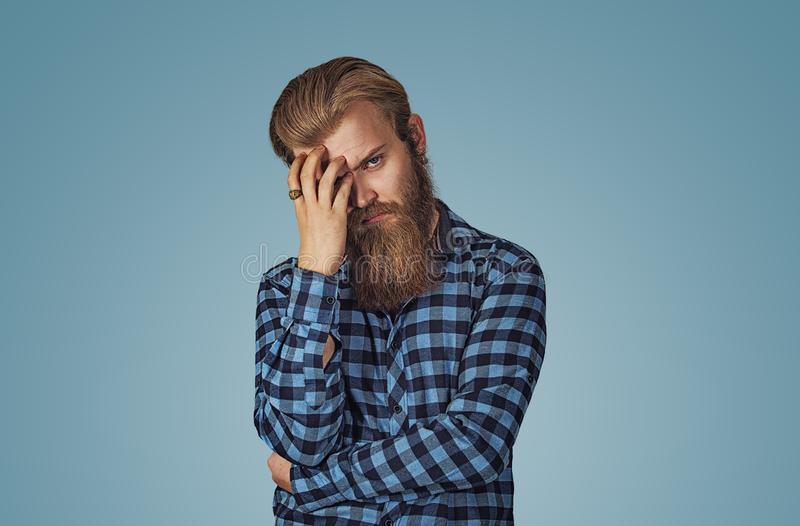 Sad young handsome bearded man stock photo