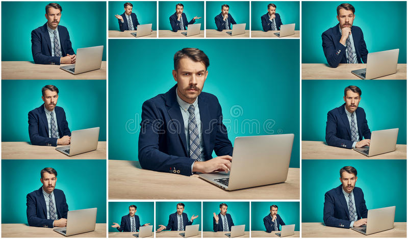 Sad Young Man Working On computer At Desk stock photo