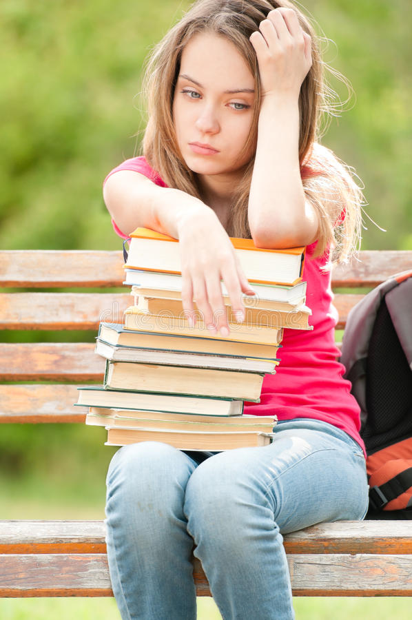 Download Sad Young Student Girl Sitting On Bench With Books Stock Image - Image: 20733967