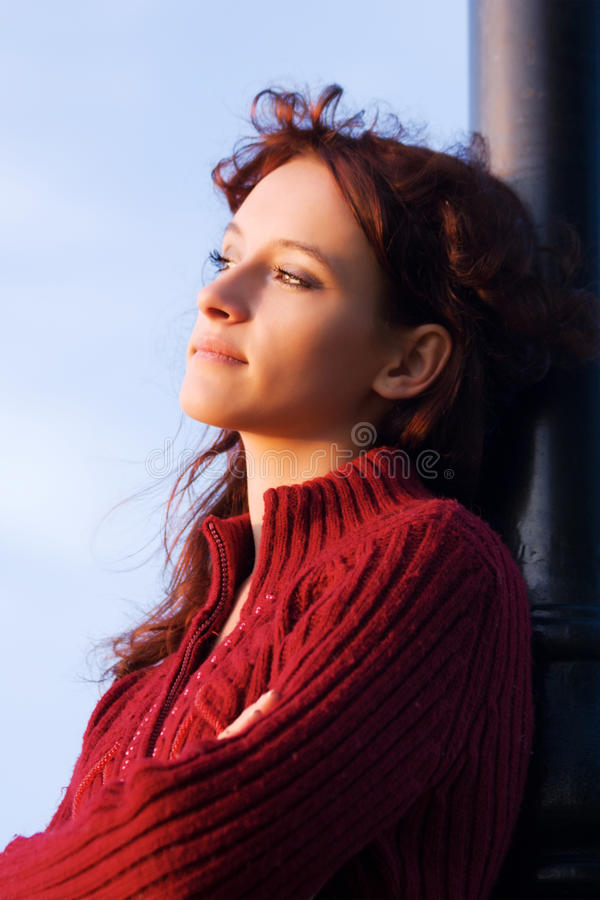 Sad young fashion woman looking away outdoor royalty free stock photo