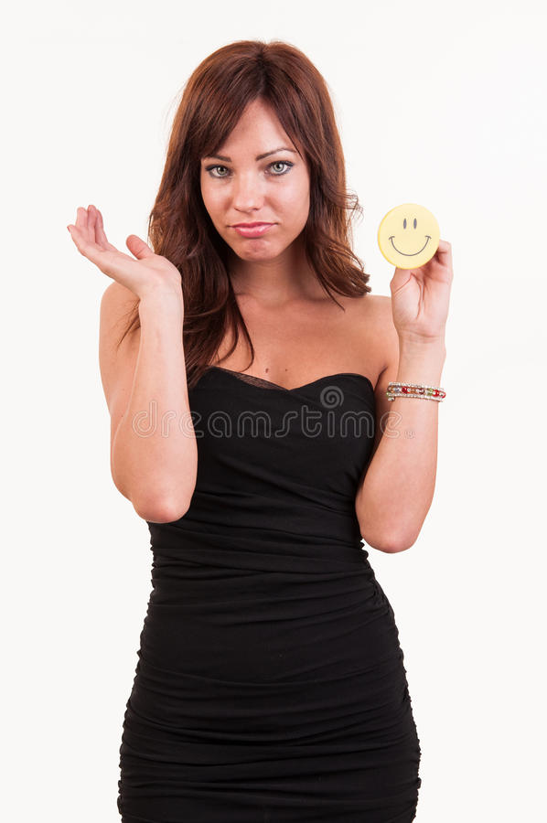 Sad young woman holding object with happy smiley royalty free stock photography