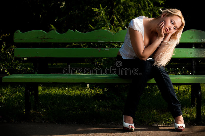 Download Sad Young Woman Sitting On Bench In Park Stock Photo - Image: 14822760