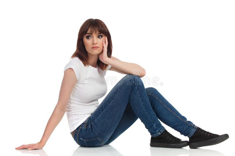 Sad Young Woman Is Sitting On Floor And Looking Away stock images