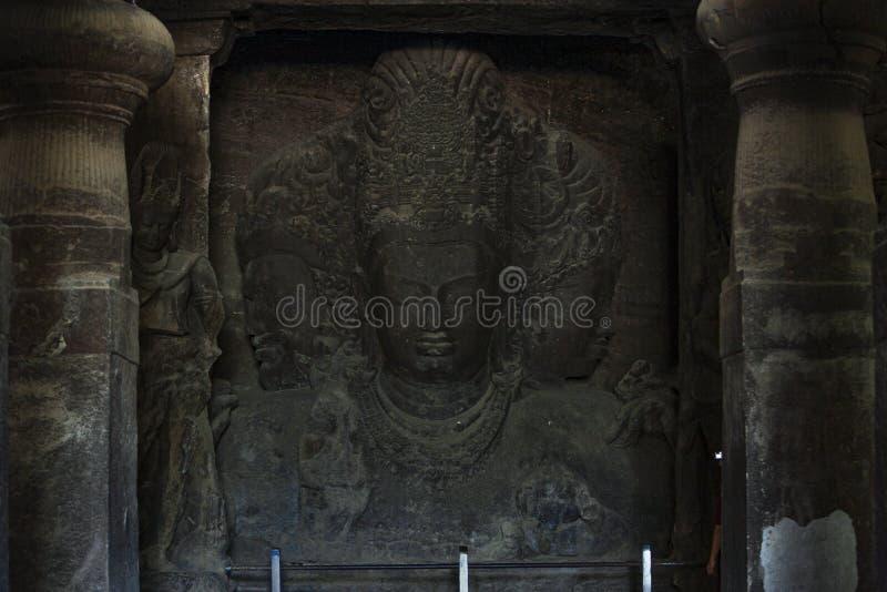Sadasiva: Trimurti som aspekter av Shiva: skapelse, skydd och förstörelse i Elephanta grottor en UNESCOvärldsarv fotografering för bildbyråer
